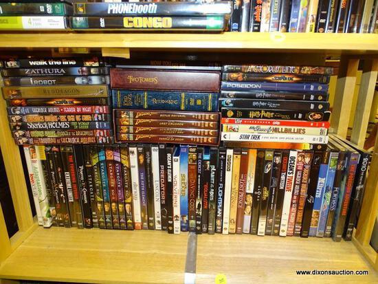 (R2) SHELF LOT OF DVDS; LOT INCLUDES 4 VOLUMES OF INDIANA JONES, OCEANS TWELVE, WOLVERINE, PIRATES