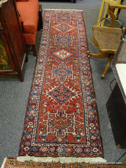 (R2) ORIENTAL RUNNER; HAND WOVEN PERSIAN ORIENTAL RUNNER IN RED, IVORY AND BLUE- 29 IN X 106 IN