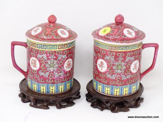 (R2) ORIENTAL MUGS; PR. OF LIDDED ORIENTAL TEA MUGS ON ROSEWOOD STANDS- 7 IN H