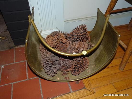 (LR) HAMMERED BRASS FIRELOG HOLDER (INCLUDES PINECONES); SITS ON 4 LEGS AND HAS A SWINGING ARCH