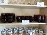 (KITCHEN) SHELF LOT OF RED GLASSWARE; 36 PIECE LOT OF RED GLASS CUPS TO INCLUDE 6 WATER CUPS, [22]