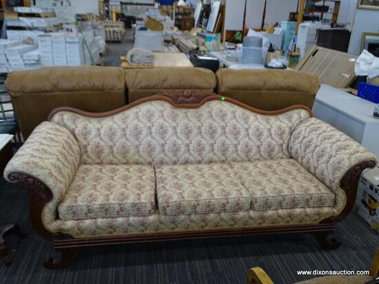 ANTIQUE SUGGS & HARDIN SOFA; EMPIRE STYLE, FLORAL UPHOLSTERED SOFA WITH A CARVED CROWN, ROLLING
