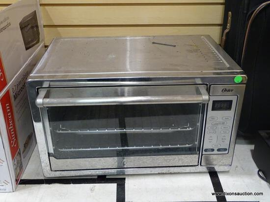 OSTER TOASTER OVEN WITH TURBO CONVECTION. MODEL NO. TSSTTVXLDG-002.