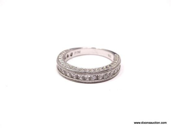 DIAMOND CHANNEL SET ETERNITY BAND. TOP 3/4 OF THE RING IS SET WITH 20 DIAMONDS. DESINGER SIGNED,