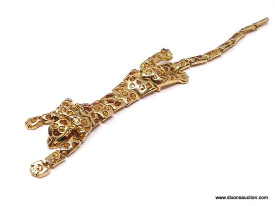 VINTAGE ARTICULATED LEOPARD SHOULDER DRAPE BROOCH/PIN . FEATURES A RICH GOLD TONE BODY, WITH