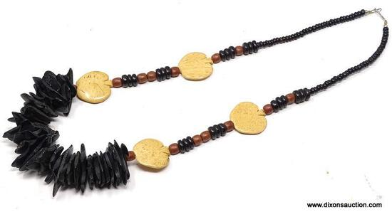 """VINTAGE ARTISAN CRAFTED CHUNKY WOOD BEAD AND WOOD CHIP NECKLACE. FEATURES A FRONT 6"""" FOCAL OF DARK"""