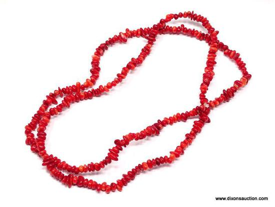 """36"""" TUMBLED AND POLISHED CORAL BEAD NECKLACE. IN VARYING WIDTHS, THE LONGEST ABOUT 1/4"""". HAND STRUNG"""