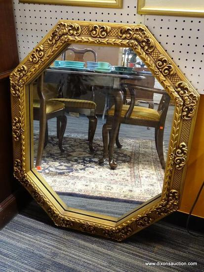 "(WALL) OCTAGONAL MIRROR; GOLD TONED, SCROLL AND FLORAL DETAILED, WLAL HANGING MIRROR. MEASURES 31"" X"