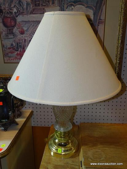 (WALL) TABLE LAMP; CUT GLASS AND POLISHED BRASS TABLE LAMP WITH A CREAM FABRIC COOLIE SHADE.