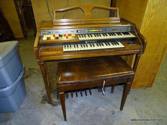 (GARAGE) ELECTRIC ORGAN; HAMMOND OAK CONSOLE ELECTRIC ORGAN WITH BENCH- 43 IN X 24 IN X 36 IN,