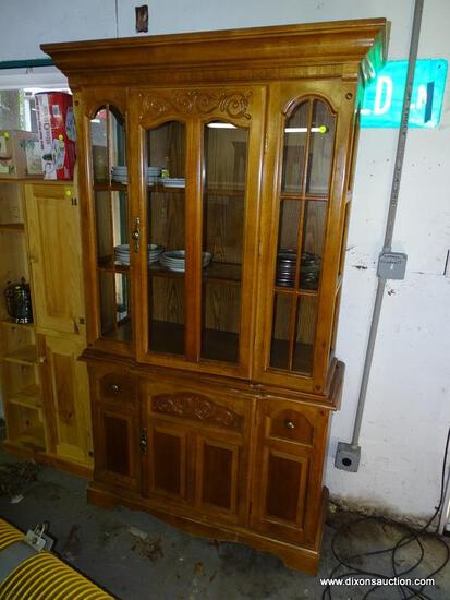 (GARAGE) CHINA CABINET; OAK 2 PC. CHINA CABINET- 1 CENTER CARVED AND GLASS DOOR WITH SIDELIGHTS, 2