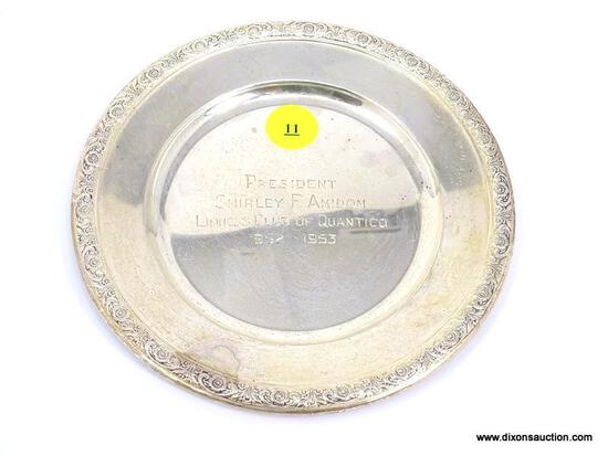 INTERNATIONAL STERLING PRELUDE PATTERN SAUCER WITH FLORAL EMBOSSED RIM. ENGRAVED WRITING IN THE