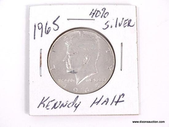 1965 40% SILVER KENNEDY HALF DOLLAR IN PROTECTIVE SLEEVE.