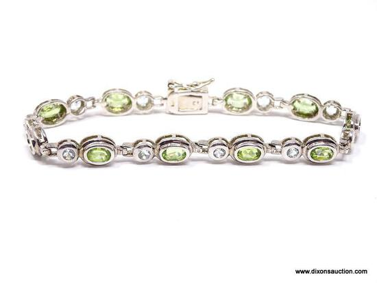 DAZZLING STERLING SILVER AND GEMSTONE BEZEL SET BRACELET. FEATURES A BOLD BOX CLASP WITH SAFETY SNAP