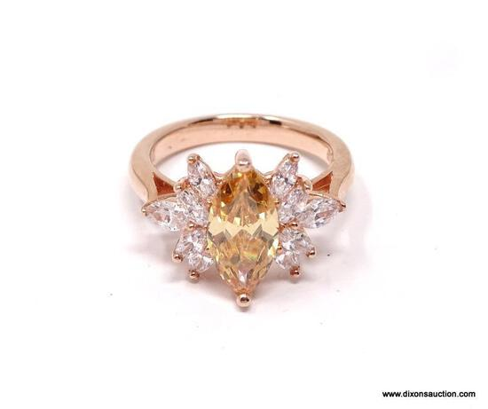 ROSE GOLD OVER STERLING SILVER DESIGNER RING, HALLMARKED WITH A DIAMOND SHAPED MARK AND .925.