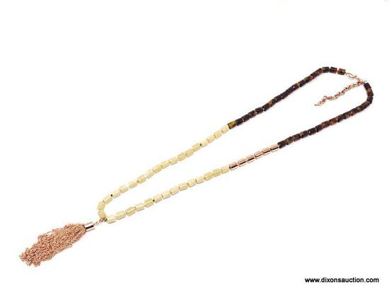 FOSSIL ROSE GOLD BEADED NECKLACE. FEATURES TORTOISE SHELL AND AGATE BARRELL BEADS, ENHANCED WITH