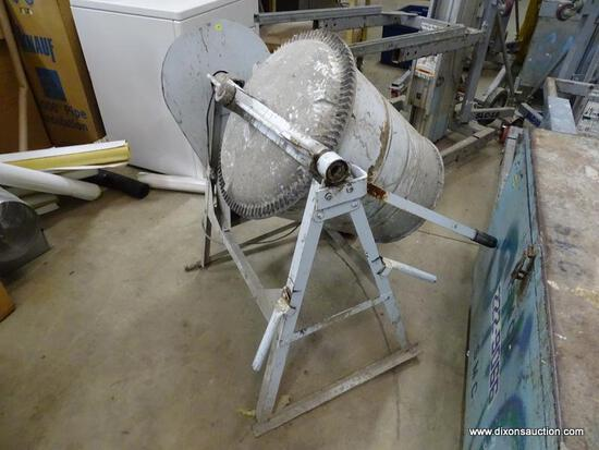 COMMERCIAL CONCRETE MIXER ON STAND. HEAVILY USED.