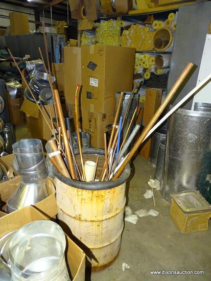 METAL DRUM FILLED WITH OVER 20 PIECES OF COPPER TUBING PIPE. ASSORTED SIZES AND LENGTHS.