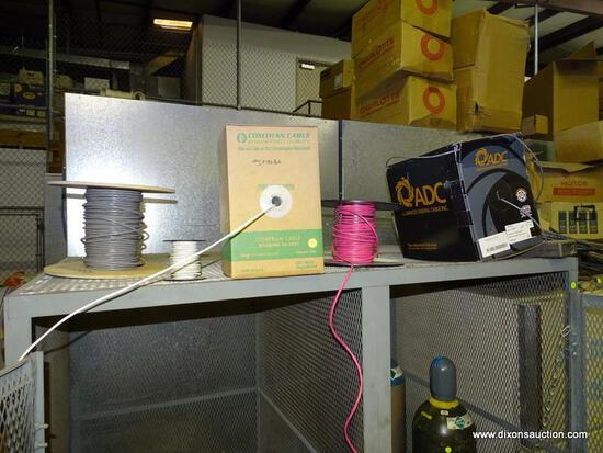 (5) SPOOL LOT ON TOP OF CAGE. CONTAINS DIFFERENT TYPES OF WIRE/CABLE.