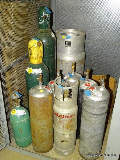 LOT OF (9) ASSORTED GAS BOTTLES. COMPRESSED OXYGEN AND ACETYLENE.