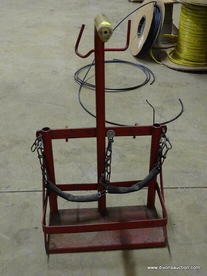 SMALL RED METAL GAS WELDING BOTTLE HOLDER.