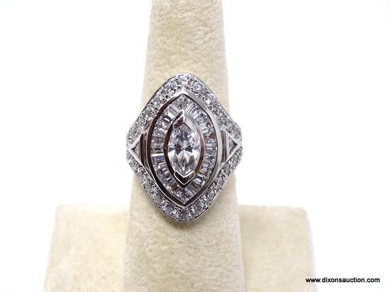 .925 STERLING SILVER RING WITH LARGE CENTER CZ STONE SURROUNDED BY SMALLER CZ STONES. COMES IN BOX.