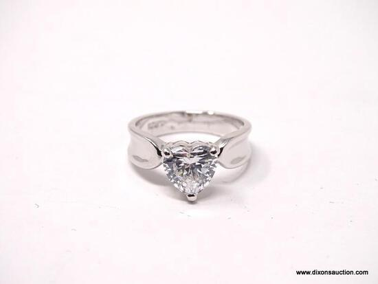 .925 STERLING SILVER RING WITH LARGE CENTER HEART SHAPED CZ STONE. COMES WITH BOX. RING SIZE IS