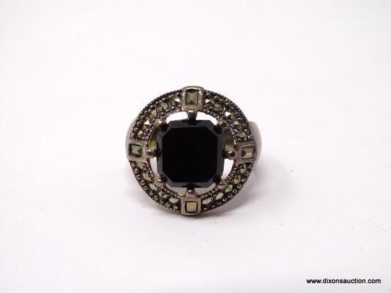 .925 STERLING SILVER RING WITH LARGE CENTER BLACK ONYX SURROUNDED BY MARCASITES. COMES WITH BOX.