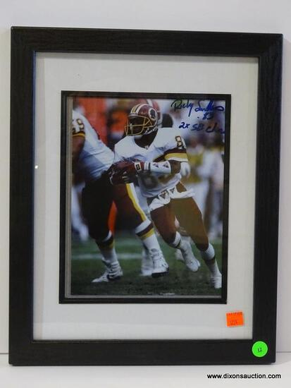 SIGNED REDSKINS PHOTOGRAPH; PHOTO IS OF AND IS SIGNED BY RICKY SANDERS. IS AN 8 IN X 10 IN