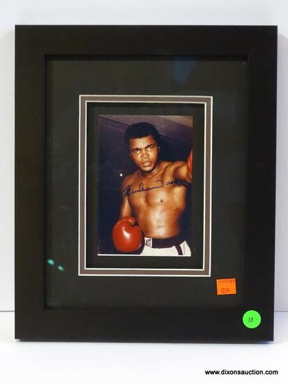 SIGNED MUHAMMAD ALI PHOTOGRAPH; IS OF AND SIGNED BY MUHAMMAD ALI WITH COA ON THE BACK FROM PRO