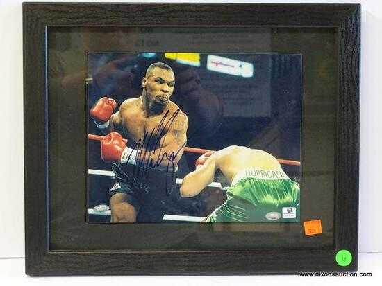 SIGNED MIKE TYSON PHOTOGRAPH; IS OF AND SIGNED BY MIKE TYSON WITH 2 COA'S ON THE BACK (1 FROM GLOBAL