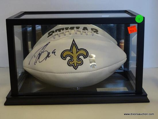 NEW ORLEANS SAINTS SIGNED FOOTBALL; SIGNED BY DREW BREES. HAS A BLACK AND GLASS PROTECTIVE CASING.