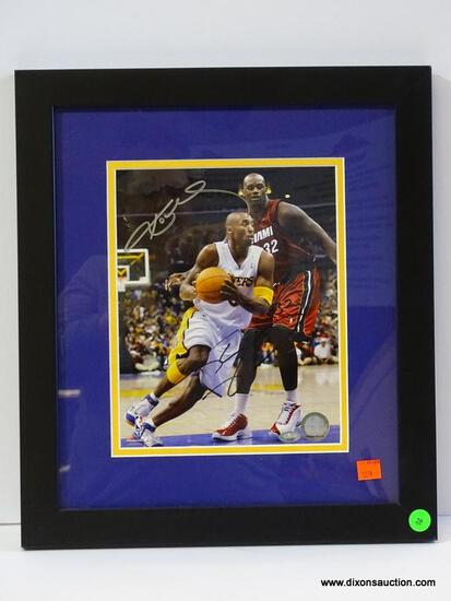 SIGNED KOBE BRYANT PHOTOGRAPH; IS OF AND SIGNED BY KOBE BRYANT WITH COA ON THE BACK FROM SPORTS