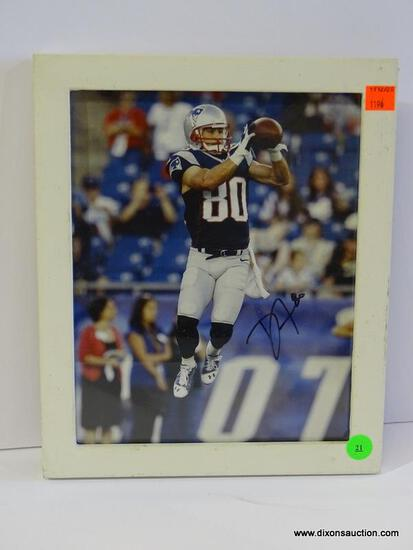 SIGNED NEW ENGLAND PATRIOTS PHOTOGRAPH; IS OF AND SIGNED BY DANNY AMENDOLA. IS IN A WHITE FRAME AND