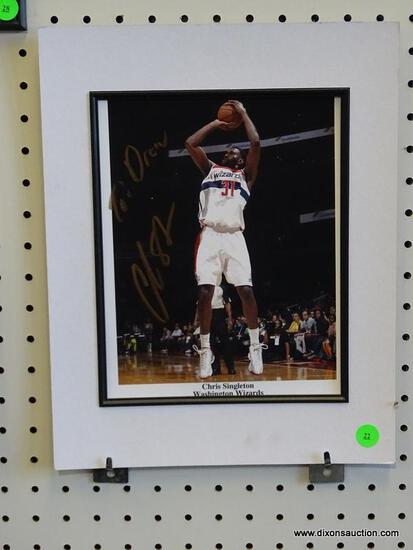 SIGNED WASHINGTON WIZARDS PHOTOGRAPH; IS OF AND SIGNED BY CHRIS SINGLETON. IS UNFRAMED AND MEASURES