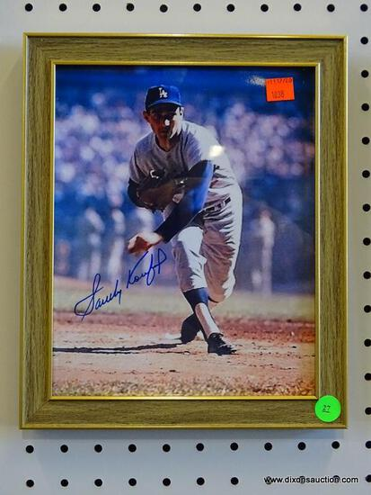 SIGNED LA DODGERS PHOTOGRAPH; IS OF AND SIGNED BY SANDY KOUFAX. HAS COA ON THE BACK FROM THE SCORE