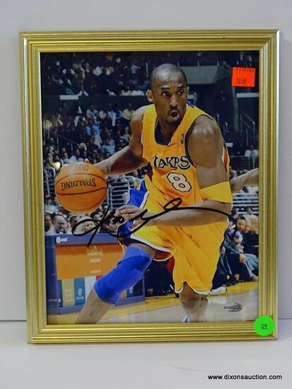SIGNED LAKERS PHOTOGRAPH; IS OF AND SIGNED BY KOBE BRYANT. HAS COA ON THE BACK FROM ALL AMERICAN