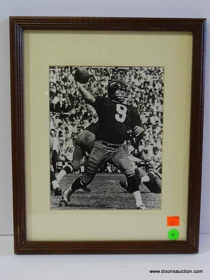 BLACK AND WHITE REDSKINS PHOTOGRAPH; IS OF SONNY JURGENSEN THROWING A FOOTBALL. IS IN A MAHOGANY