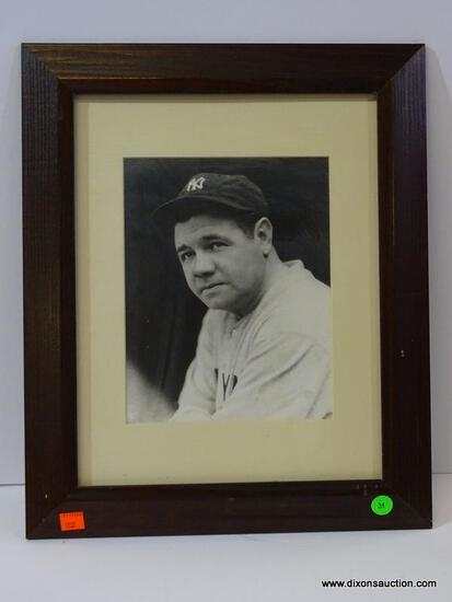BLACK AND WHITE NEW YORK YANKEES PHOTOGRAPH; IS OF BABE RUTH. IS IN A MAHOGANY FRAME AND MEASURES 14