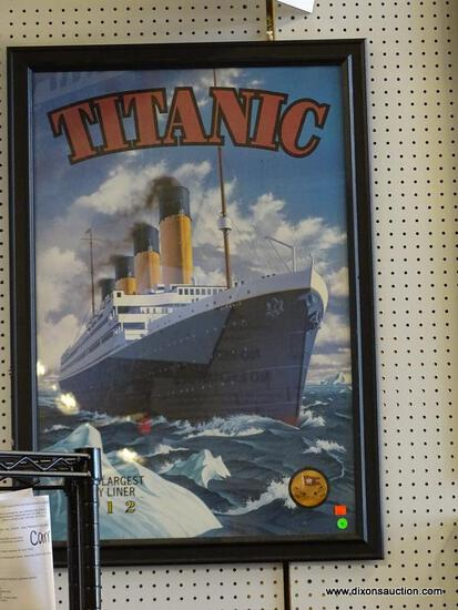 """FRAMED TITANIC PRINT; """"WORLDS LARGEST LUXURY LINER 1912"""". IS IN A BLACK FRAME AND MEASURES 27.5 IN X"""