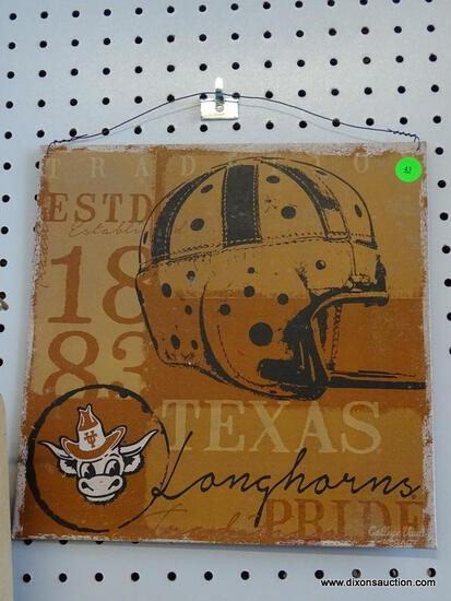 TEXAS LONGHORN ADVERTISING SIGN; IS BROWN AND BLACK IN COLOR. MEASURES 11.5 IN X 11.5 IN