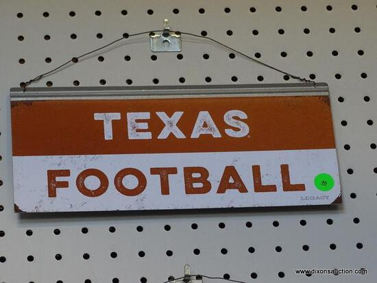 TEXAS FOOTBALL ADVERTISING SIGN; IS BROWN AND WHITE IN COLOR. MEASURES 12 IN X 5.5 IN