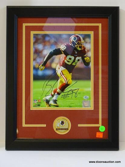 SIGNED REDSKINS PHOTOGRAPH; PHOTO IS OF AND IS SIGNED BY BRIAN ORAKPO. IS AN 8 IN X 10 IN PHOTOGRAPH