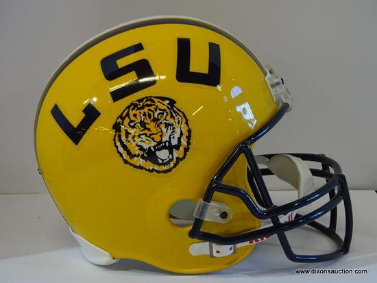 TROPHY HELMET; LSU TROPHY FOOTBALL HELMET IN YELLOW, BLACK, AND WHITE. NOT TO BE USED FOR ACTIVE