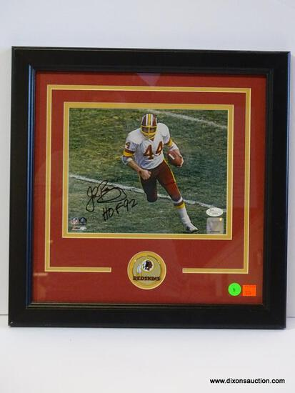 SIGNED REDSKINS PHOTOGRAPH; PHOTO IS OF AND IS SIGNED BY JOHN RIGGINS. IS AN 8 IN X 10 IN PHOTOGRAPH