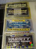 ASSORTED LICENSE PLATE FRAMES; INCLUDES A SAN JOSE STATE, A UNC, A MARQUETTE, A UCLA, AND AN OHIO
