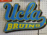 UCLA BRUINS SIGN; IS BLUE, BLACK, AND YELLOW IN COLOR AND MEASURES 22 IN X 18 IN