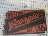 GEORGIA BULLDOGS ADVERTISING SIGN; IS RED AND BLACK IN COLOR. MEASURES 16 IN X 13 IN
