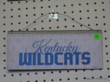 KENTUCKY WILDCATS ADVERTISING SIGN; IS BLUE AND GRAY IN COLOR. MEASURES 12 IN X 5.5 IN
