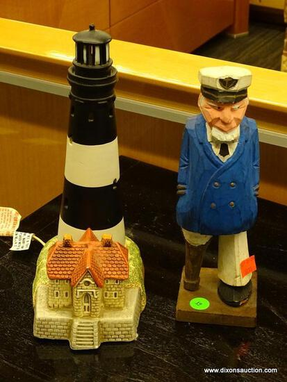 2 PIECE LOT; INCLUDES A WOODEN CARVED SEA CAPTAIN WITH A PEG LEG AND A LEFTON CHINA LIGHT HOUSE